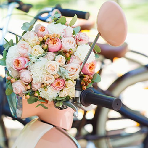 Wedding decoration details, closeup of flower bouquet on retro b